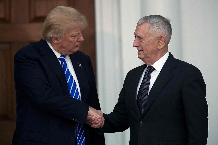 US President-elect Donald Trump with retired United States Marine Corps General James Mattis after their meeting on Nov 19, 2016.