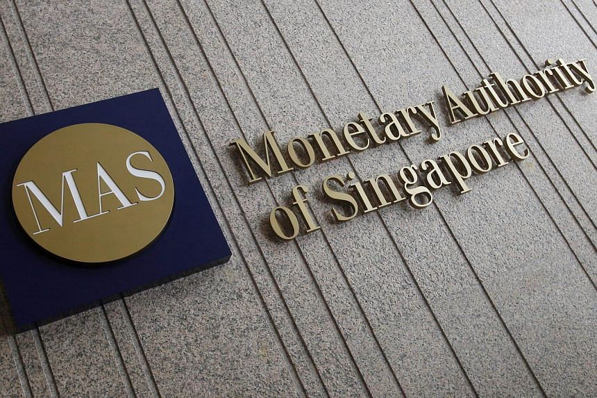 The logo of the Monetary Authority of Singapore is pictured at its building in Singapore.