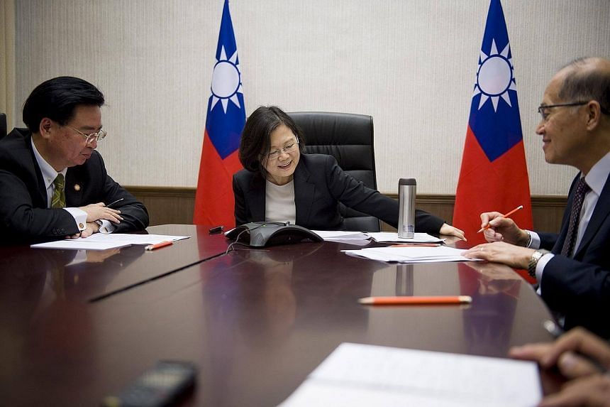 A handout picture released by the Office of the President Taiwan on Dec 3, 2016, shows Taiwanese President Tsai Ing-wen (centre) having a phone conversation with US President-elect Donald Trump late evening in Taipei, Taiwan, Dec 2, 2016.