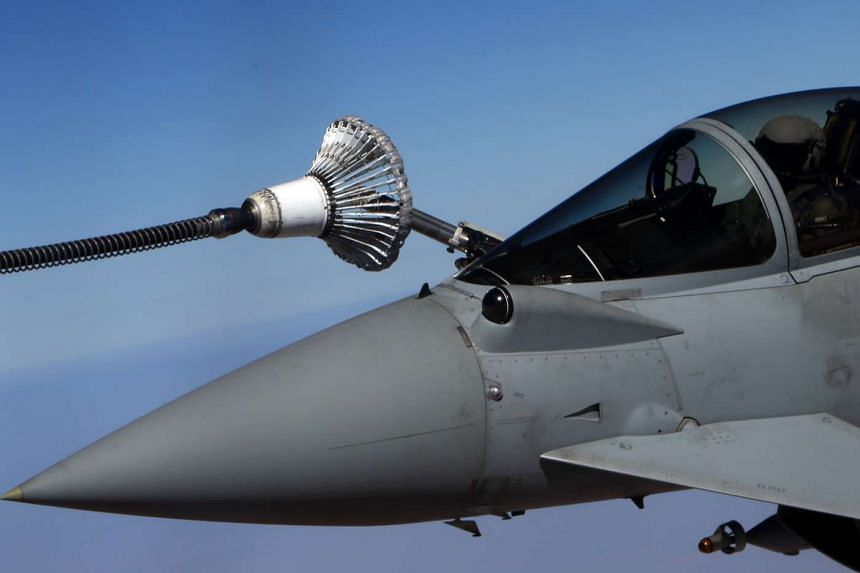 A British Royal Air Force Eurofighter Typhoon fighter jet refueling from a tanker aircraft over Iraq in September 2016.