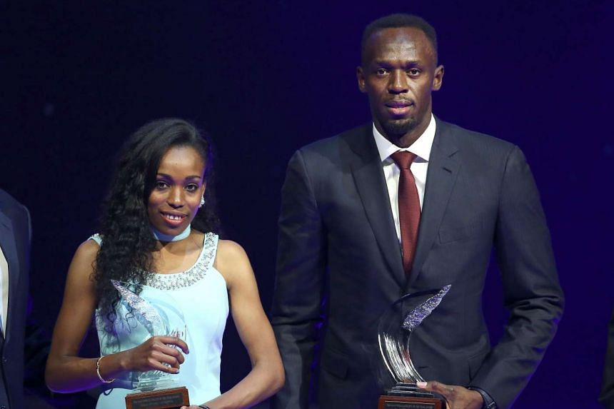 Usain Bolt of Jamaica (R) and Almaz Ayana of Ethiopia pose with their awards.