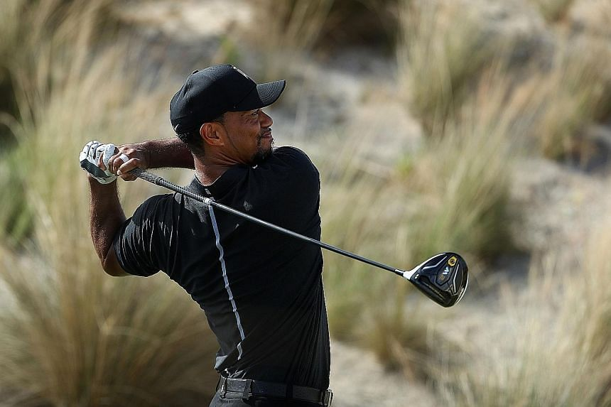 Tiger Woods hitting his tee shot on the third hole in round one of the Hero World Challenge. He showed glimpses of his old self, sharing the lead after eight holes.