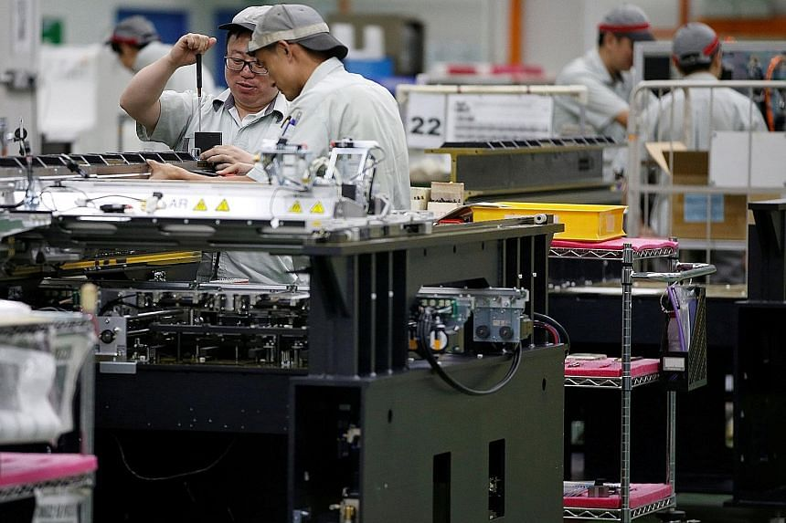 A printed circuit board assembly factory in Singapore. DBS economist Irvin Seah said the outlook for manufacturing, which makes up a fifth of Singapore's economy, is becoming more sanguine on the back of stronger US growth.