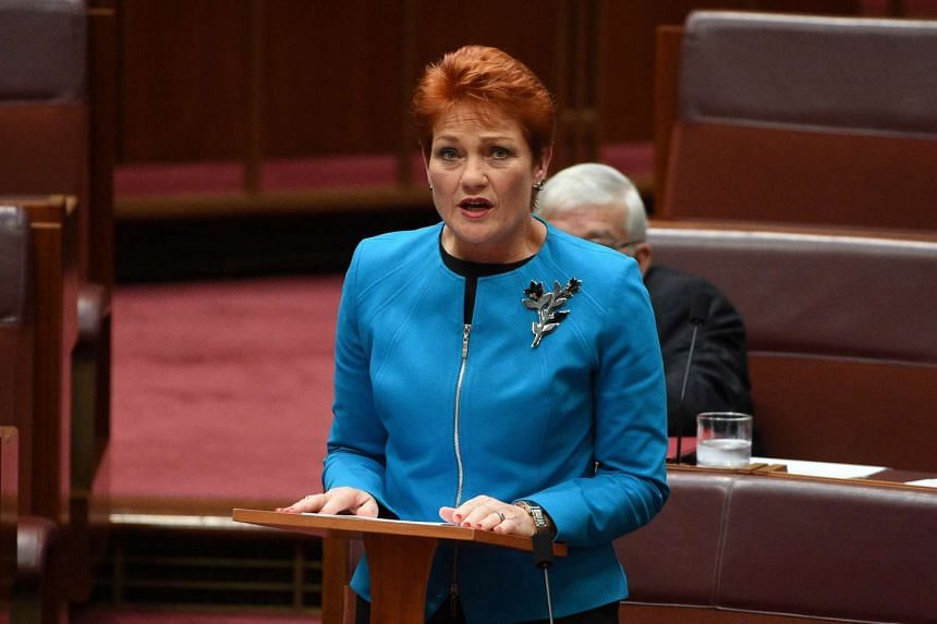 One Nation party leader Pauline Hanson making her maiden speech in Australia's Senate on Sept 14. The anti-migrant party won a surprising four seats  in the 76-member Senate in elections this year.