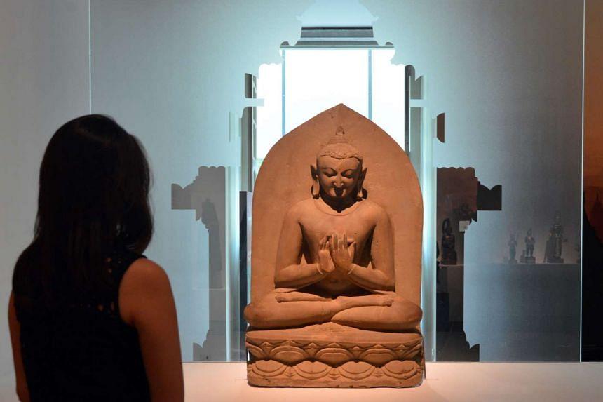 Buddha seated in dharmachakramudra ,Bagan, 11th century, sandstone,115x68x26cm, Bagan Archaeological Museum