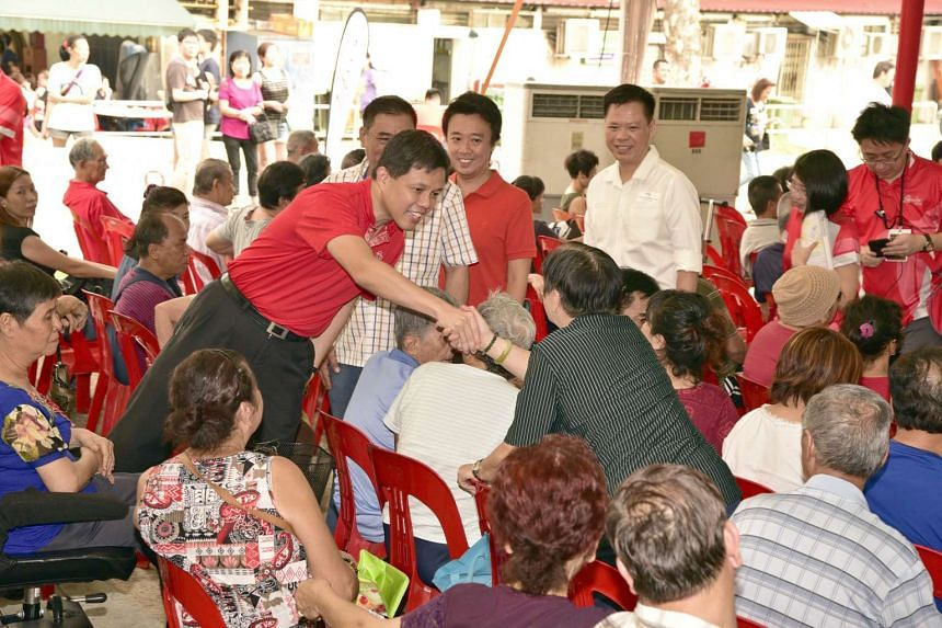 Minister in the Prime Minister's Office Chan Chun Sing greeting residents during the launch of the PAssion Silver Concession card, on Dec 4, 2016.