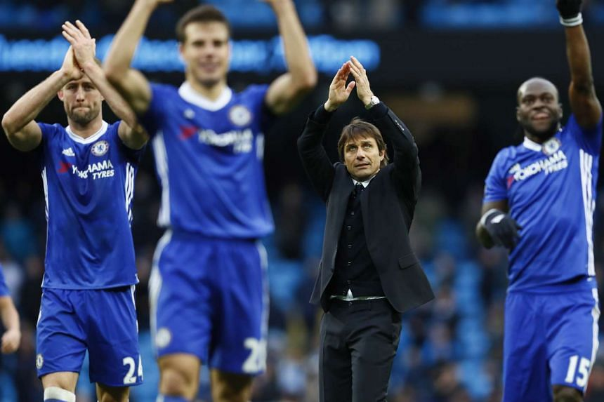 Chelsea manager Antonio Conte and players applaud fans after the game.