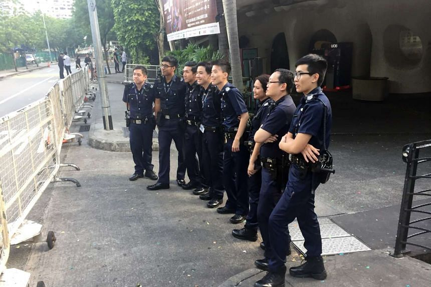 Police officers pose for a photo outside Zouk on Dec 4, 2016.