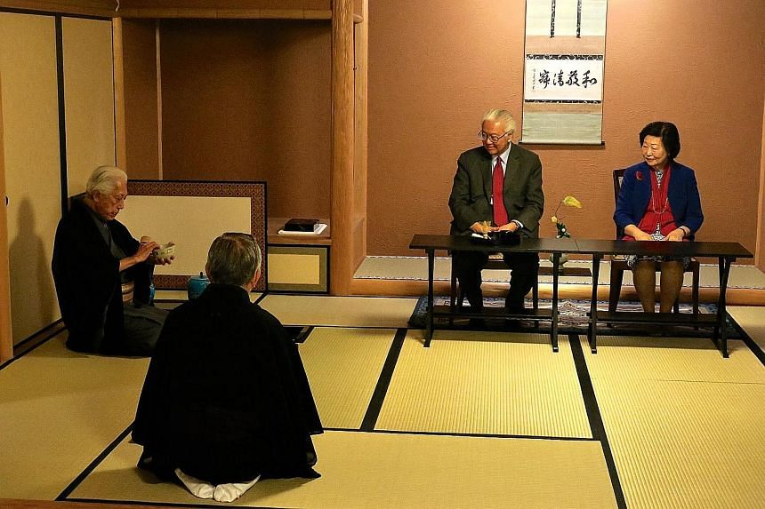 President Tony Tan Keng Yam and his wife, Mrs Mary Tan, being hosted to a traditional tea ceremony by Japanese grand master Genshitsu Sen (left) of the Urasenke Konnichian tea school in Kyoto. WATCH THE VIDEO President Tony Tan at a tea ceremony led