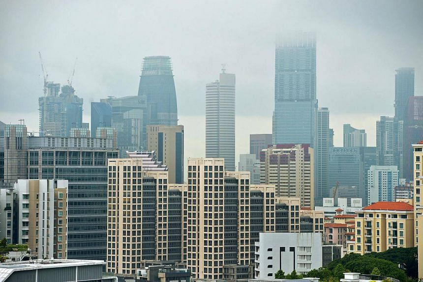 Blocks of high-rise condominiums seen against the skyline of Singapore's central business district.