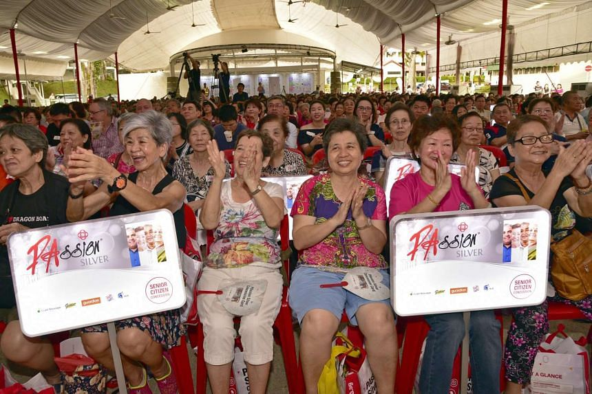 Elderly residents clapping during the launch of the new PAssion Silver Concession card, at Commonwealth Crescent on Dec 4, 2016.