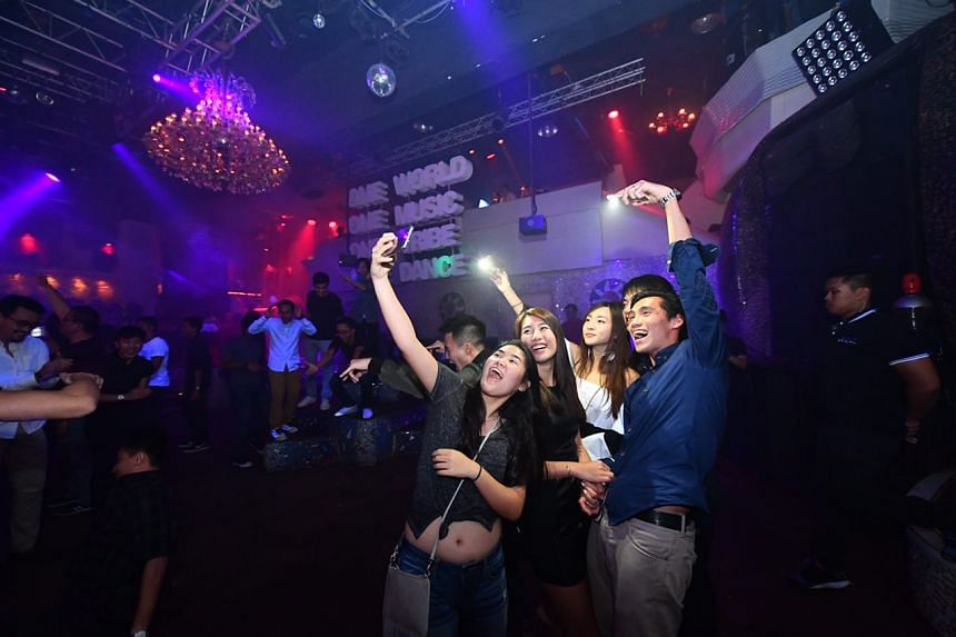 Club-goers capture the moment with a selfie.