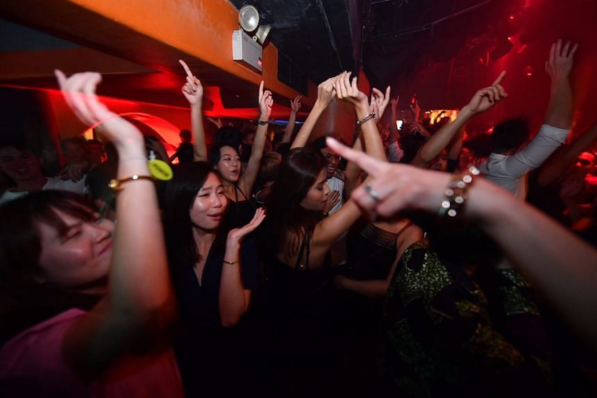 Club-goers in the party mood in the Phuture room.