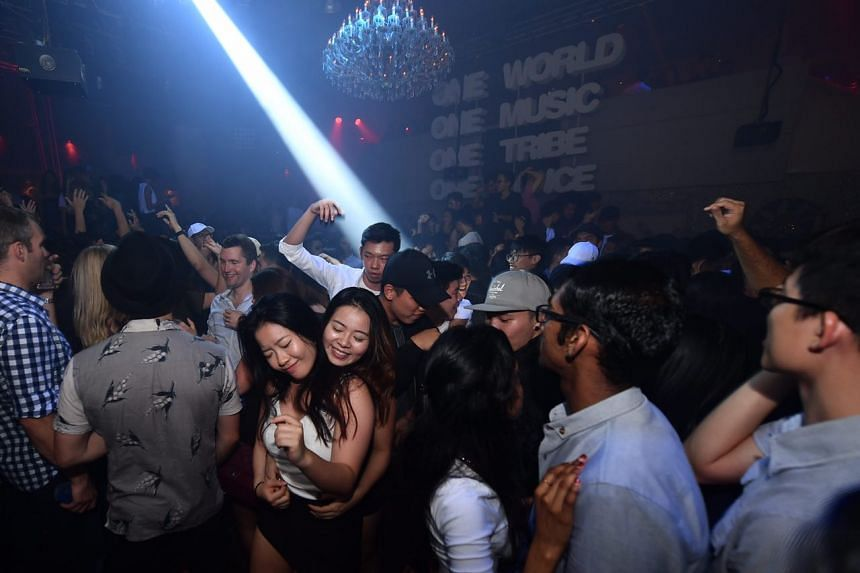 Club-goers in the party mood in the main room.