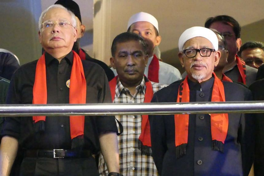 Prime Minister Najib Razak and Abdul Hadi Awang, president of the opposition Parti Islam SeMalaysia (PAS), joined the rally calling for protection of the Rohingya minority.