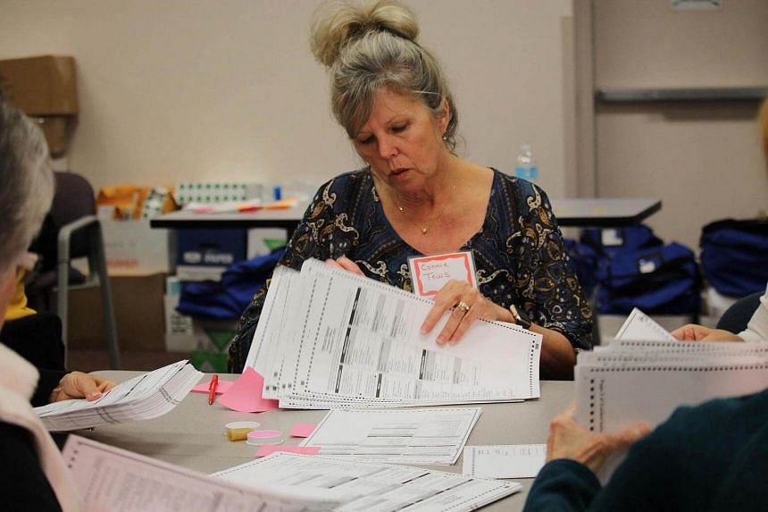 Connie Tews counts ballots in Kenosha, Wisconsin on Dec 2, 2016, as part of a historic effort is being undertaken, at the request of Green Party candidate Jill Stein, to recount the vote in three key US states where Democratic candidate Hillary Clint