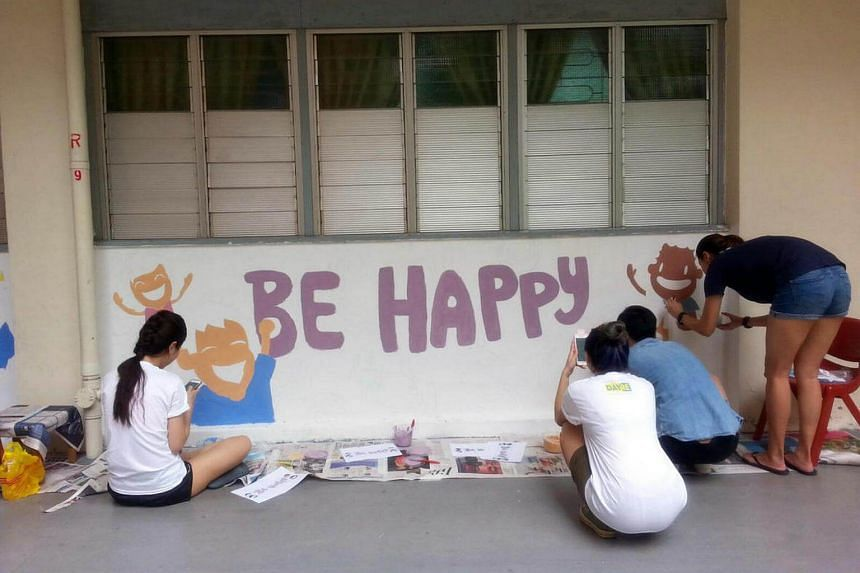Volunteers painting the walls of Singapore Children's Society student care centres as part of Giving Week 2016.