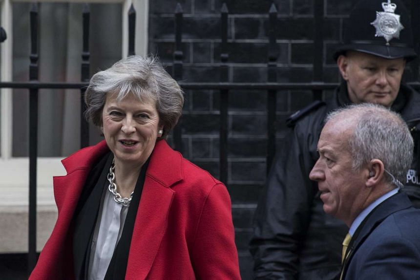 Britain's Prime Minister Theresa May leaves No. 10 Downing Street to attend Prime Ministers Questions at the House of Commons in London on Nov 30, 2016.