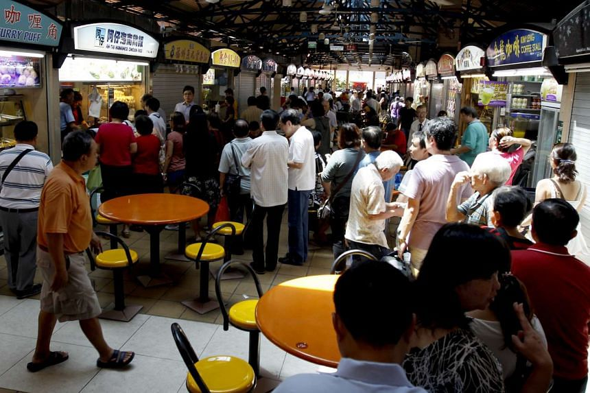 Lunch hour at Ah Tai Chicken Rice at Maxwell Food Centre yesterday saw a queue of about 30 people.