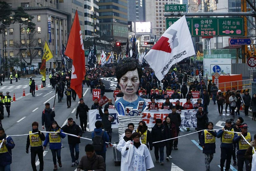 Members of the Korean Confederation of Trade march during a protest against South Korean President Park Geun Hye in Seoul on Nov 30, 2016.