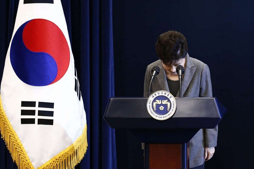 South Korean President Park Geun Hye bows during an address to the nation, at the presidential Blue House in Seoul on Nov 29, 2016.