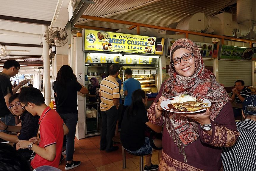 Mizzy's Corner owner Mizrea Abu Nazir with ikan kuning nasi lemak at her stall. By February, Indian mackerel will be used instead.