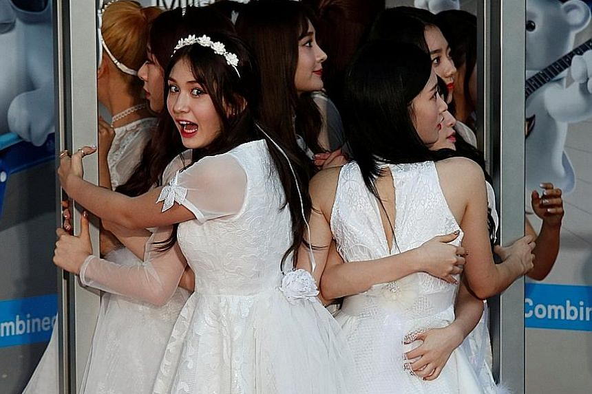 Members of South Korean girl group I.O.I squeezed into a photo booth for a selfie during the Mnet Asian Music Awards in Hong Kong. At the annual K-pop honours last Friday, boyband BTS won Artist of the Year. K-pop group EXO won Album of the Year for