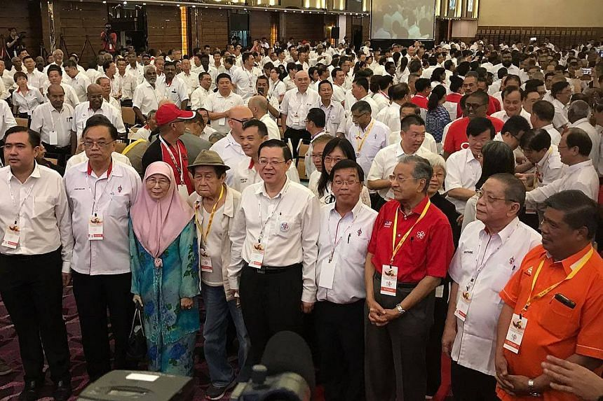 Dr Mahathir (third from right), with veteran DAP leader Lim Kit Siang (second from right), PKR leader Wan Azizah Ismail (second from left) and other opposition leaders at the convention on Sunday.