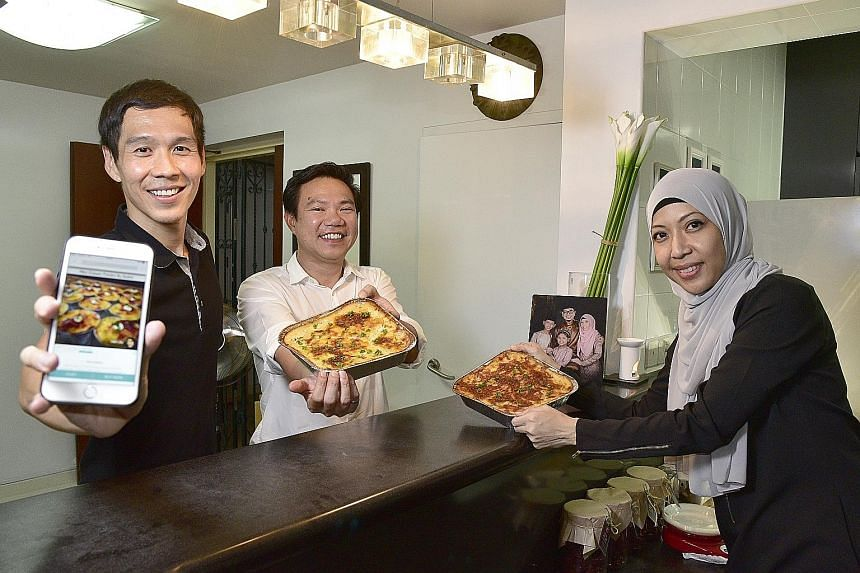 Hcook co-founders (from left) Renton Yap and Loh Kua Meng, 39, with Madam Herny Kamal, a housewife who sells food through the mobile app, which connects home cooks with hungry buyers.