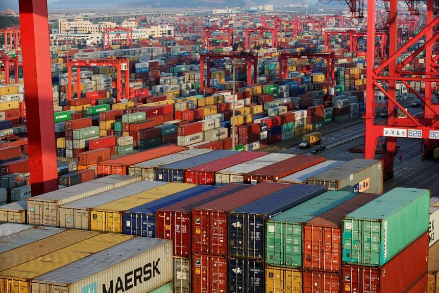 Container boxes are seen at the Yangshan Deep Water Port, in the Shanghai Free Trade Zone, on Sept 24, 2016.