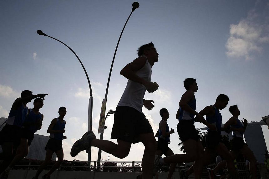 Participants of the SAFRA Singapore Bay Run and Army Half Marathon, flagged off from the Esplanade Bridge.