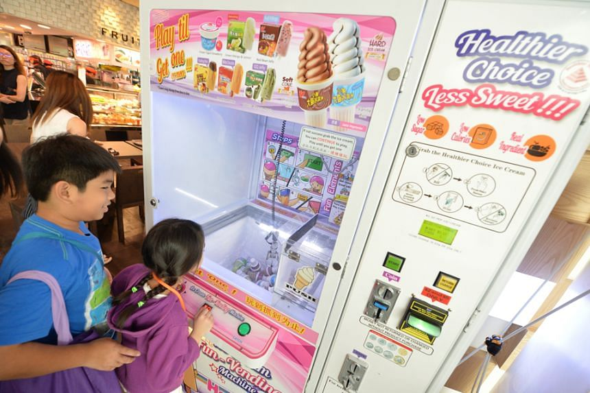 Children excitedly trying out the machine outside a foodcourt at Changi City Point mall on Monday (Dec 5) morning.