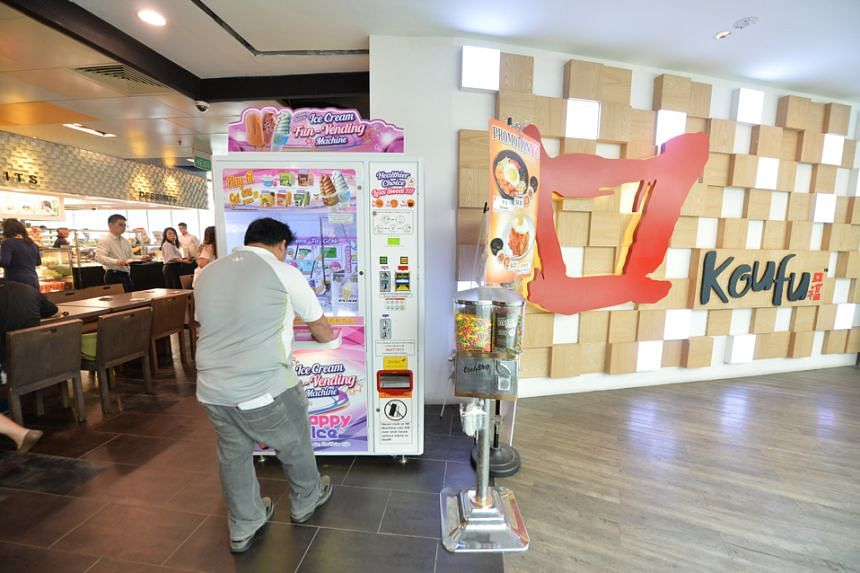 Happy Ice's vending machines operate like arcade claw machines, where players try to pick up an item from a mechanical claw.