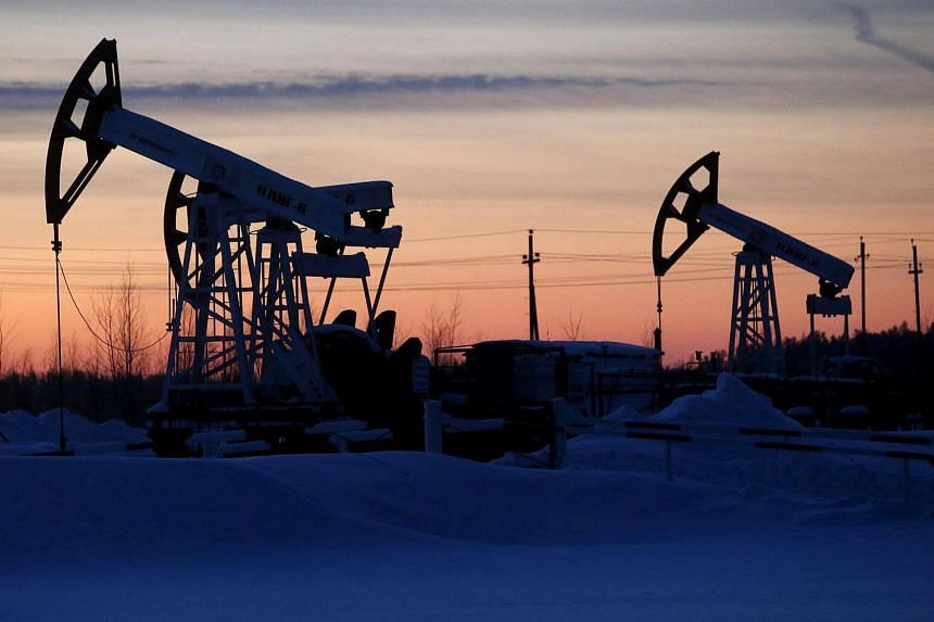 Pump jacks are seen at the Lukoil company owned Imilorskoye oil field outside the west Siberian city of Kogalym, Russia on Jan 25, 2016.