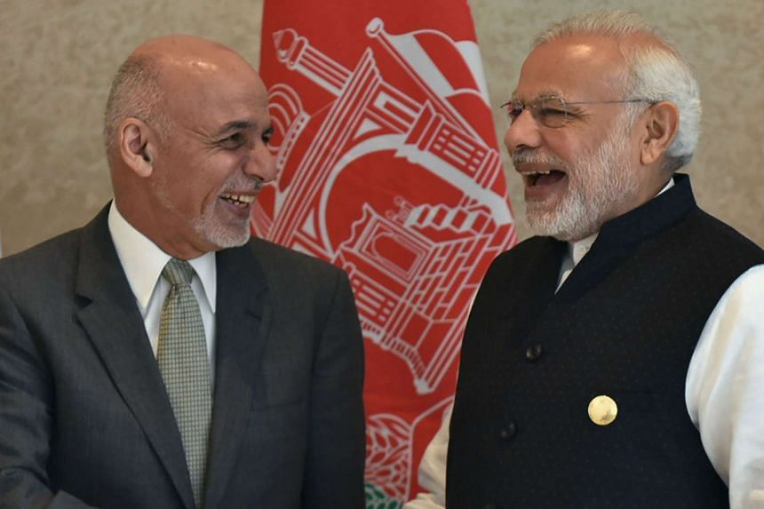 Indian Prime Minister Narendra Modi (right) shakes hands with Afghan President Ashraf Ghani (left) during the 6th Heart of Asia Ministerial Conference on Dec 4, 2016.