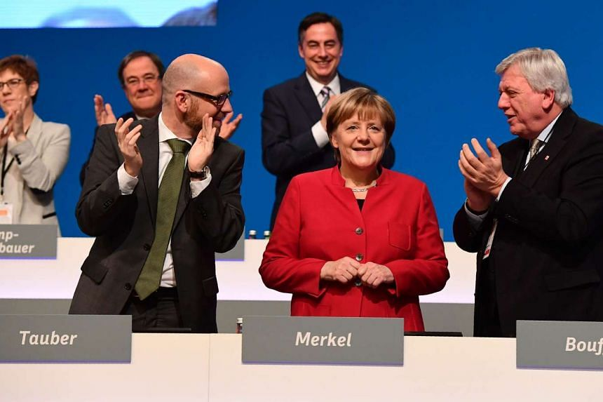 German Chancellor Angela Merkel is applauded after addressing delegates during her conservative Christian Democratic Union (CDU) party's congress in Essen, western Germany, on Dec 6, 2016.