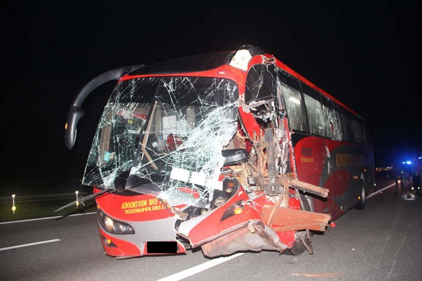 The wreckage of the bus, after it was involved in an accident along the North-South Expressway early on Dec 5, 2016.