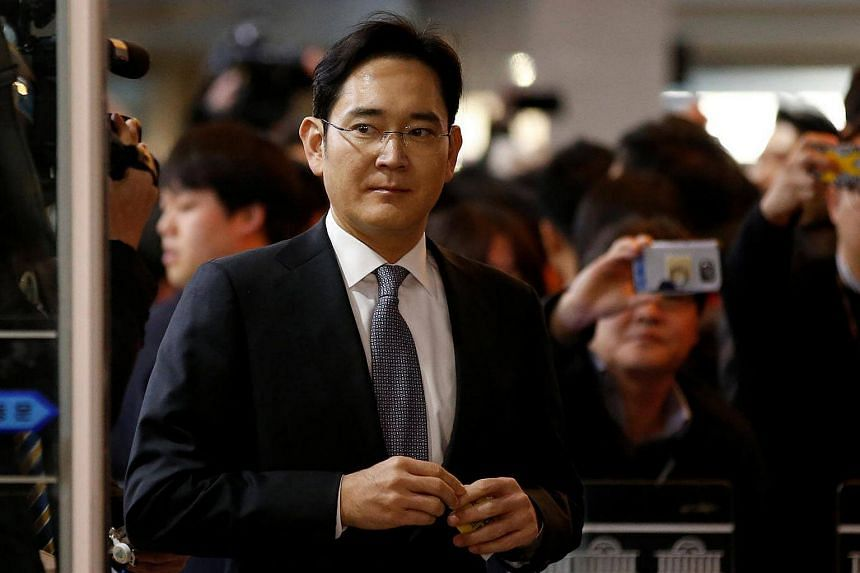Samsung Electronics vice-chairman Jay Y. Lee arrives to attend a hearing at the National Assembly in Seoul, South Korea, on Dec 6, 2016.