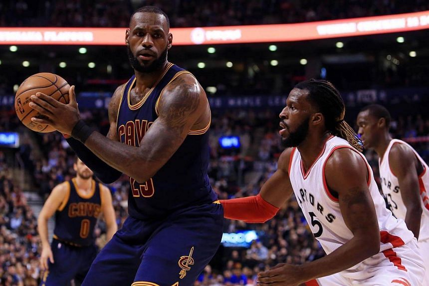 Lebron James #23 of the Cleveland Cavaliers dribbles the ball as DeMarre Carroll #5 of the Toronto Raptors defends during the first half of an NBA game on Dec 5, 2016.