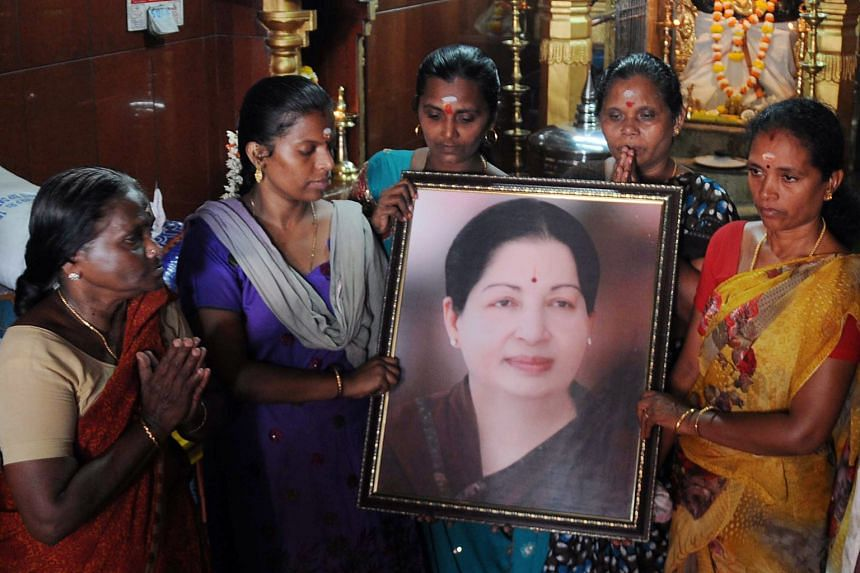 Supporters of Ms Jayalalithaa offering prayers for her health yesterday.