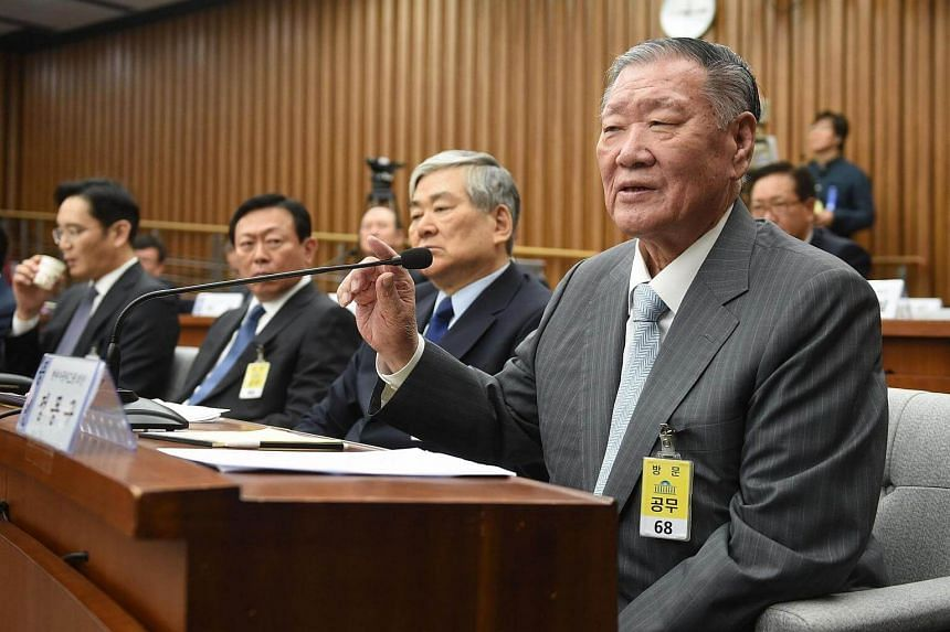 Hyundai Motor Group Chairman Chung Mong Koo (right) answering a question during a parliamentary probe into a scandal engulfing President Park Geun Hye at the National Assembly in Seoul on Dec 6, 2016.