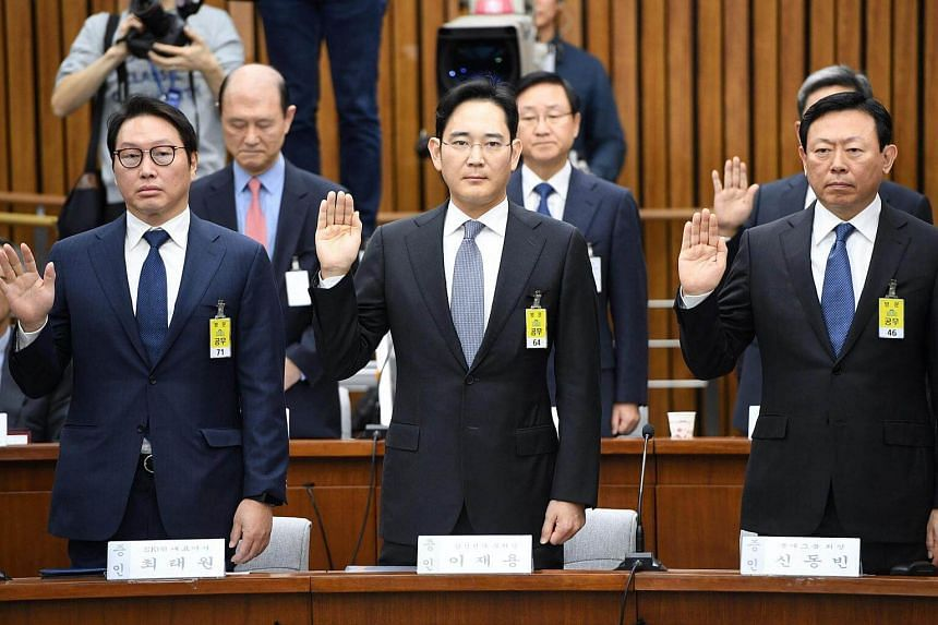 (From left) SK Group chairman Chey Tae Won, Samsung Group's heir-apparent Lee Jae Yong and Lotte Group Chairman Shin Dong Bin take an oath during a parliamentary probe into a scandal engulfing President Park Geun Hye at the National Assembly in Seoul