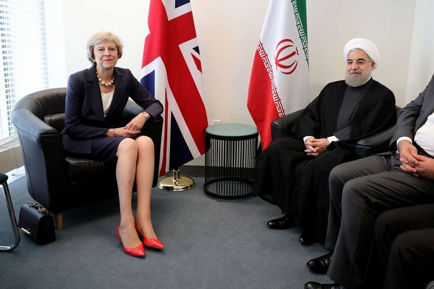 British Prime Minister Theresa May and the President of Iran, Hassan Rouhani pose as they meet before a bilateral meeting during the United Nations General Assembly on Sept 20, 2016 in New York City.