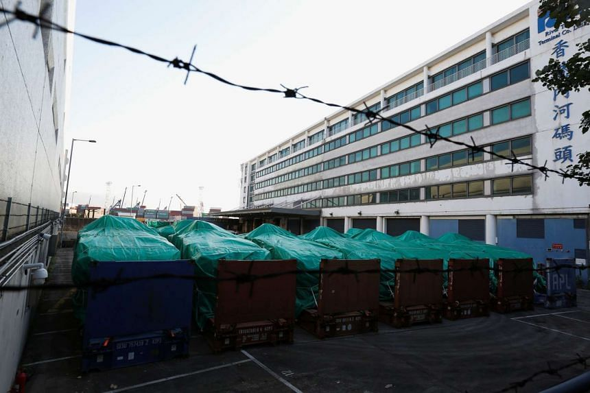 Armoured troop carriers, belonging to Singapore, are detained at a cargo terminal in Hong Kong, on Nov 28, 2016. P
