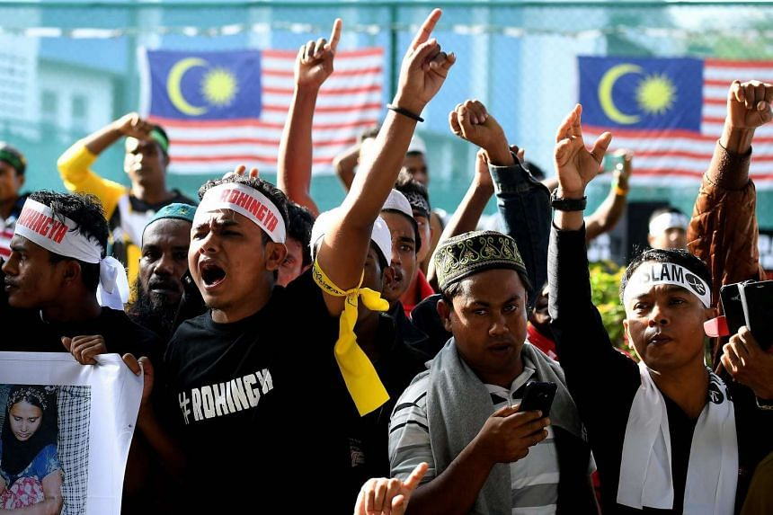 Ethnic Rohingya Muslim refugees shout slogans during a gathering in Kuala Lumpur on Dec 4, 2016, protesting the persecution of Rohingya Muslims in Myanmar.