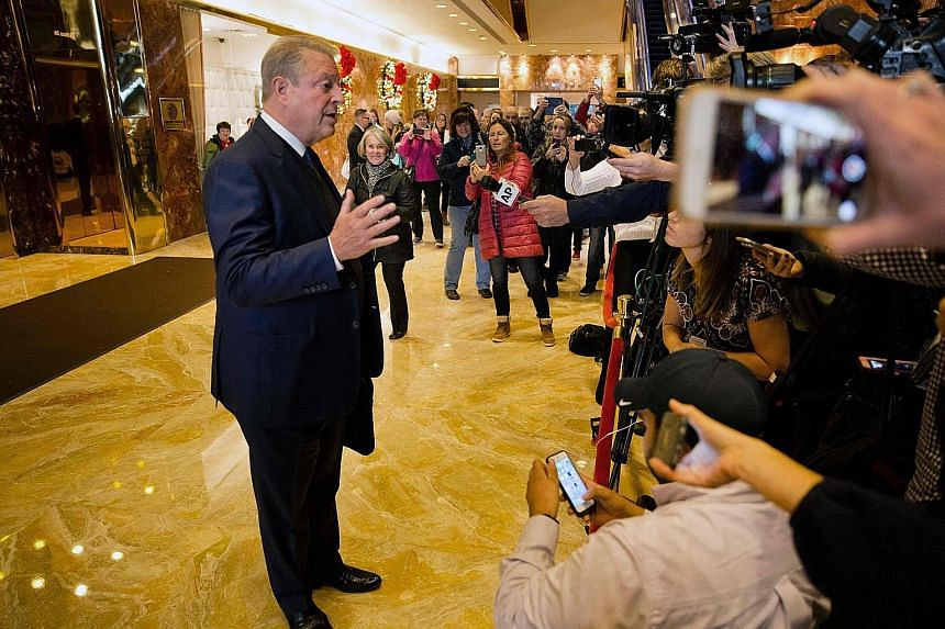 "Mr Gore speaking to the media at the Trump Tower in New York City on Monday. He said he had a ""lengthy and productive session"" with Mr Trump."