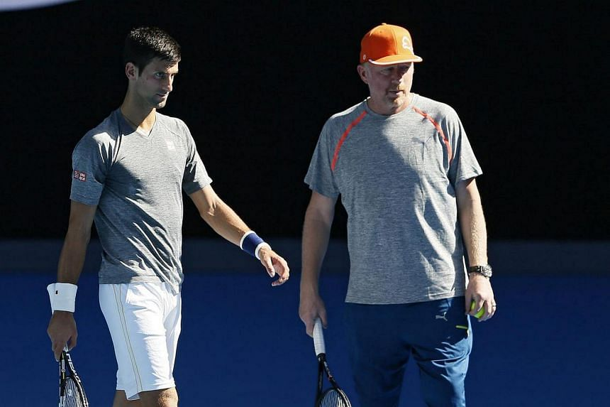 Novak Djokovic of Serbia (left) and his coach Boris Becker during a practice session of the Australian Open Grand Slam tennis tournament, on Jan 17, 2016.