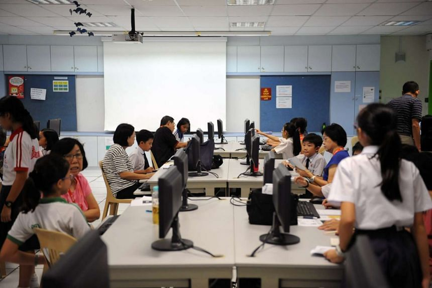 Some seniors taking a free basic computer skills course at Chongfu school under the Council for Third Age's Intergenerational Learning Programme.