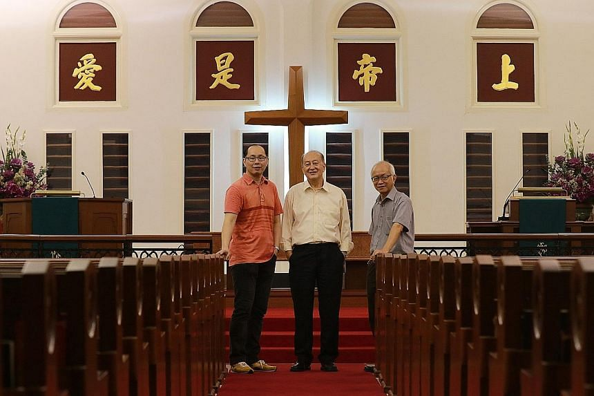 (Above, from left) Mr Winston Tay, 42, preacher and operations and admin manager; his father, Mr David Tay, former chairman of the property committee; and Mr Edward Wu, chairman of the property committee. They are in front of panels with gold-leafed