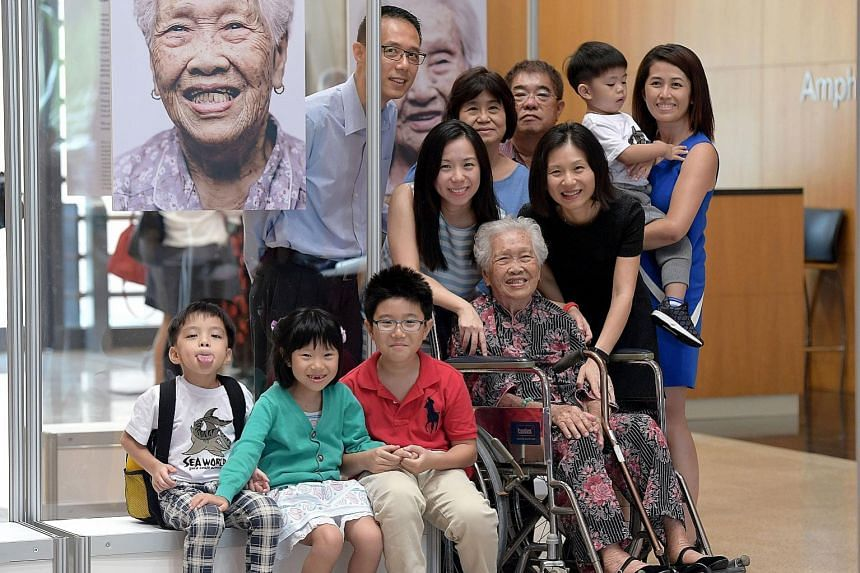 Behind Madam Tan (from left) are grandson-in-law Simon Teng, 49; granddaughter Wee Pei Sze, 36; daughter-in-law Ho Hin Tock, 64; son Wee Tai Jeok, 68; granddaughter Eveline Wee, 41; great-grandson Wee Zee Kay, three, and granddaughter-in-law Png Ying